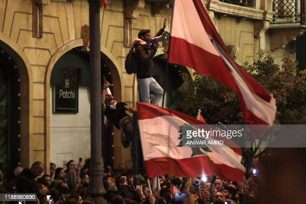 A Lebanese protester addresses the crowd during an antigovernment demonstration in the downtown area of the capital Beirut on December 15 2019...