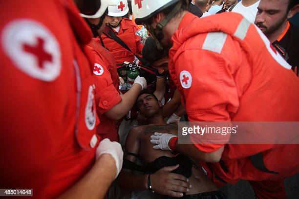 A Lebanese protester receives first aid after clashes that followed a demonstration organized by 'You Stink' campaign to protest against the ongoing...