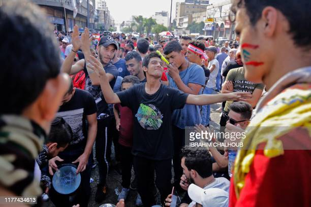 Lebanese protesters attend a rally in the northern city of Tripoli during the fifth day of demonstrations against tax increases and official...