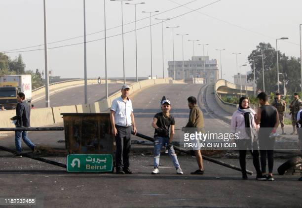 Lebanese protesters block the southern entrance of the northern Lebanese city of Tripoli on November 14 2019 Lebanese protesters blocked main roads...