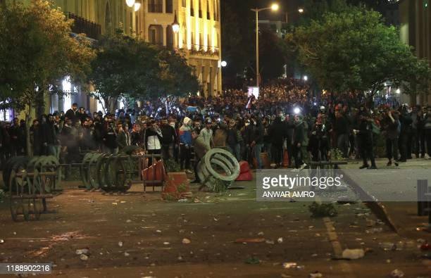 Lebanese protesters face-off with security forces during an anti-government demonstration in the downtown area of the capital Beirut on December 15,...