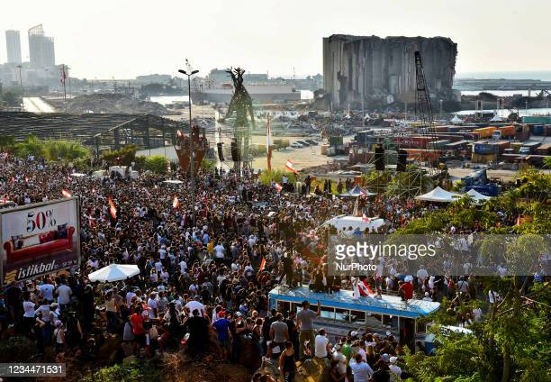 Lebanese protesters gathered in mourning near Beirut's port on August 4, 2021 in Beirut, Lebanon. - Lebanese commemorate the 218 people who died and...