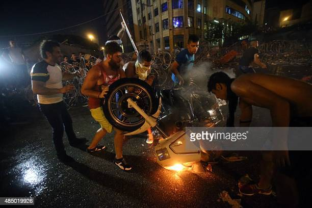 Lebanese protesters set a police motorcycle on fire during clashes with riot police following a demonstration organized by 'You Stink' campaign to...