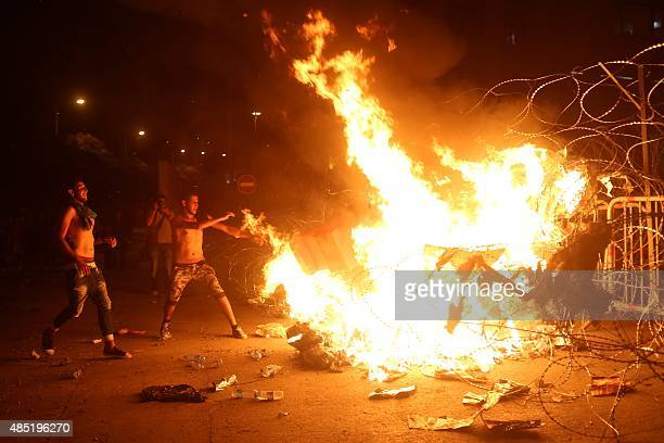 Lebanese protesters set on fire piles of rubbish durig clashes with security forces following a demonstration against the ongoing trash crisis on...