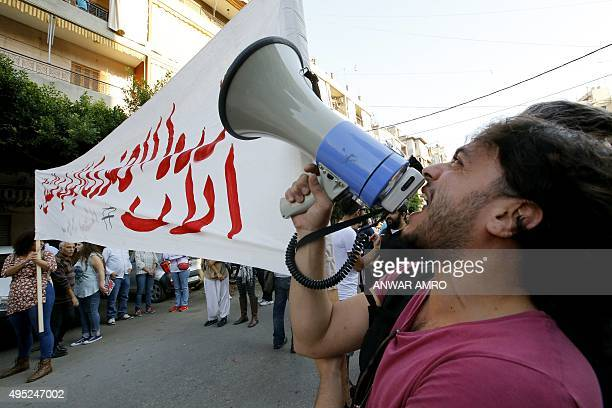 Lebanese protesters shout slogans during a demonstration organized by civil society groups to protest against the country's ongoing trash crisis on...