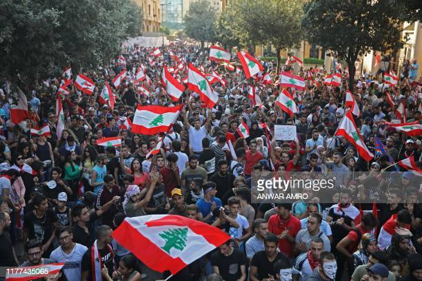 Lebanese protesters take to the streets during demonstrations to demand better living conditions and the ouster of a cast of politicians who have...