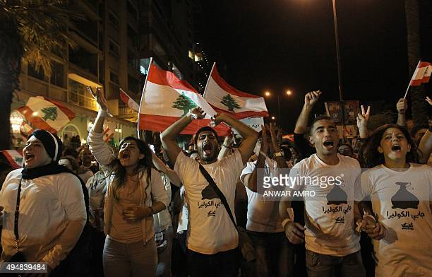 Lebanese protesters wave the national flag and shout slogans during a demonstration organized by 'You Stink' campaign to protest against the...