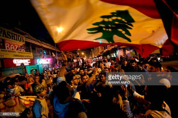 Lebanese protesters wave the national flag and shout slogans during a demonstration organised by civil society groups to protest against the...