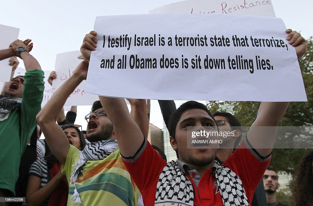 A Lebanese protestor shouts slogans and holds a placard during a demonstration in Beirut on November 15, 2012, denouncing the Israel's ongoing military operation in the Gaza Strip. Israel carried out 24 hours of air strikes on Gaza, killing several Palestinians, including Hamas militants.