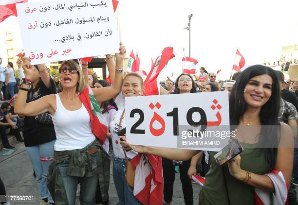Lebanese protestors shout slogans during demonstrations to demand better living conditions and the ouster of a cast of politicians who have...