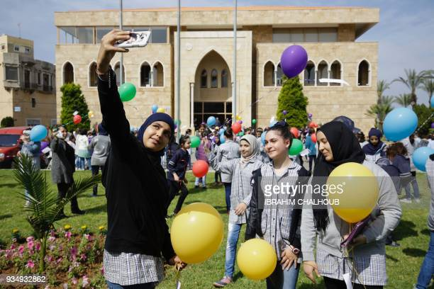Lebanese public school students take a selfie picture as they take part in a release of balloons carrying personalized messages written in French to...