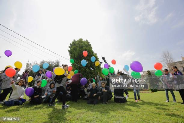 Lebanese public school students take part in a release of balloons carrying personalized messages written in French to celebrate the Frenchspeaking...