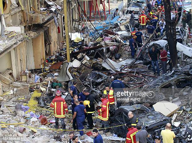 Lebanese rescue workers and firefighters inspect the site of an explosion in Beirut's Christian neighbourhood of Ashrafieh on October 19, 2012. A...