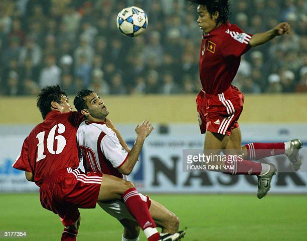 Lebanese Rodar Antar fights for the ball with Vietnamese Tran Hai Lam and Nguyen Huy Hoang during a qualyfying football match between Vietnam and...