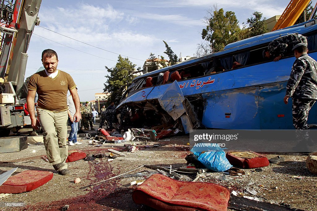 Lebanese security forces and civilians inspect the scene of a bus crash, killing and wounding several people, in the town of Kahaleh, ten kilometres east of Beirut on March 15, 2013, that was carrying Syrian refugees upon their arrival from Syria to Lebanon.