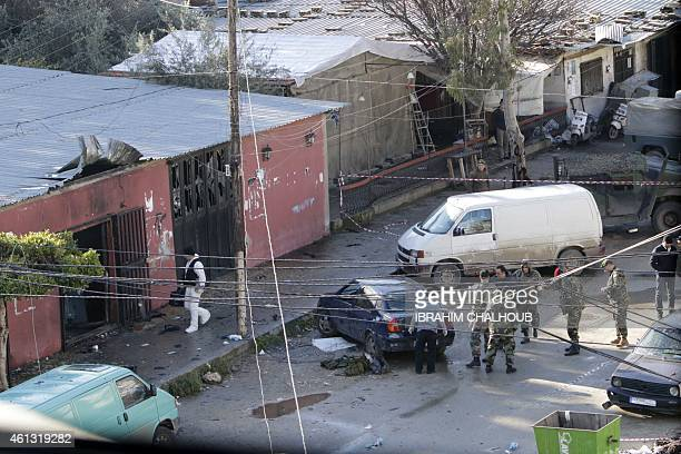 Lebanese security forces and forensics work on January 11 2015 at the site of a suicide bombing a day after it killed 9 people in an attack on a cafe...