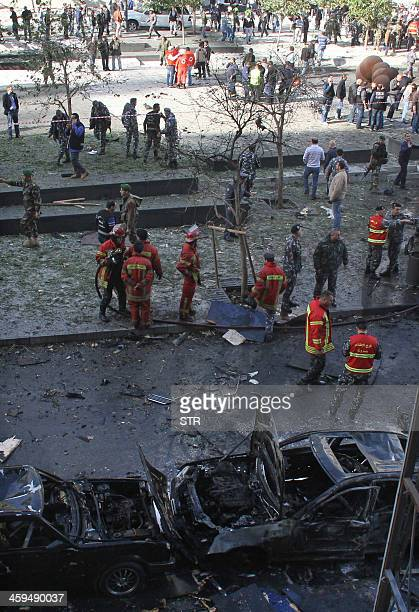 Lebanese security forces and rescue teams gather at the scene of a car bomb explosion that rocked central Beirut on December 27 killing an adviser to...