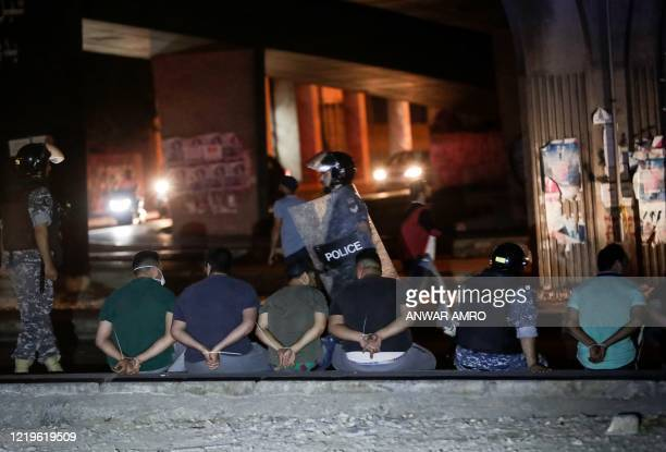 Lebanese security forces arrest a group of men during an anti-government demonstration against dire economic conditions, under the Fuad Shehab bridge...