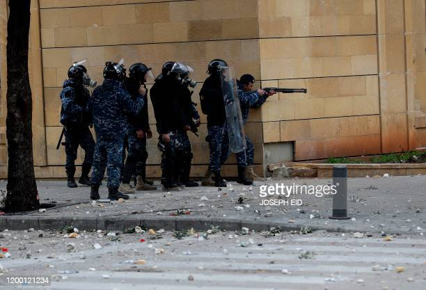 Lebanese security forces fire rubber bullets to disperse demonstrators during a protest in the heart of Beirut to stop a confidence vote for a new...