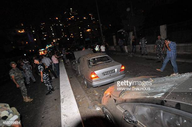 Lebanese security forces inspect the scene of a blast on a bridge at the entrance of the northern port city of Tripoli on August 6 2014 AFP...