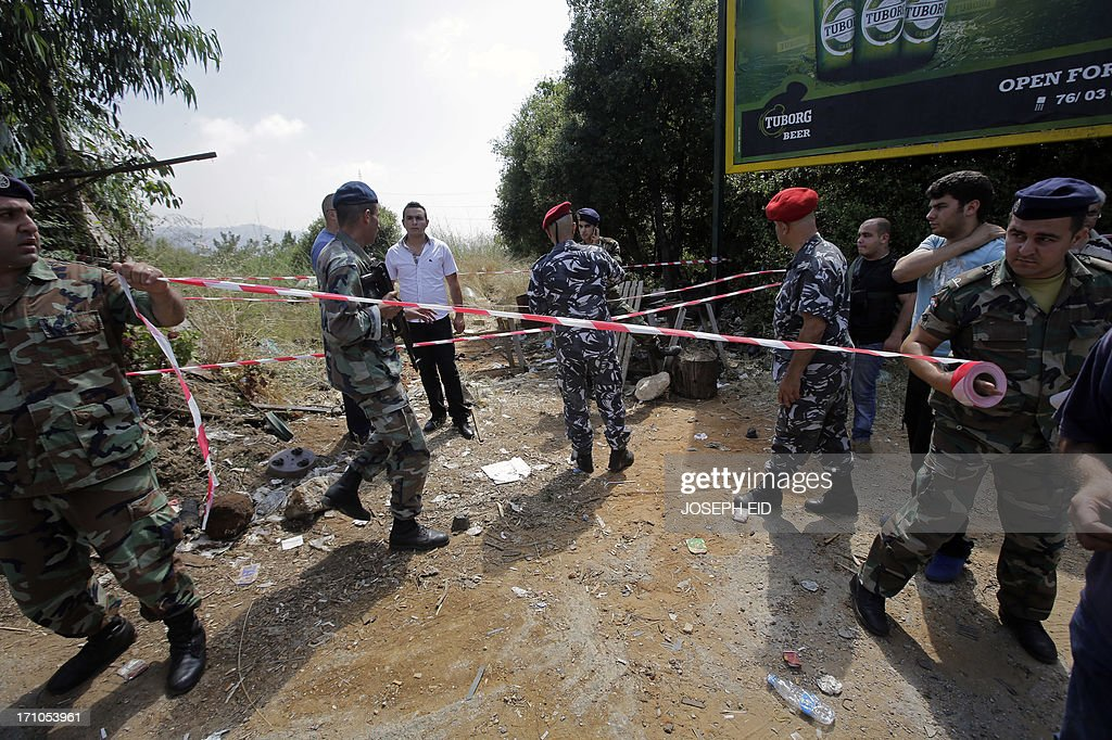 Lebanese security forces secure the area where a missile failed to launch near the town of Balluneh, north of Beirut, on June 21, 2013. A Grad rocket fired from north of the Lebanese capital exploded near the city overnight, a security source said, adding that the army also found a second rocket at the launch site.
