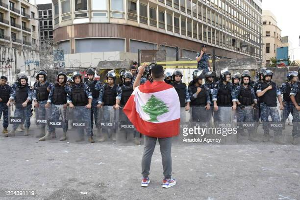 Lebanese security forces take measures against people protesting against dire economic conditions political groups Central Bank officials and...