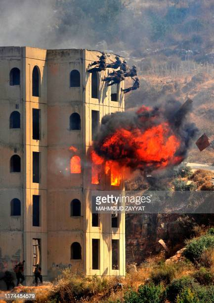 Lebanese security forces take part in a drill simulating a chemical weapons attack on October 8 2019 in the town of Kfar Falous