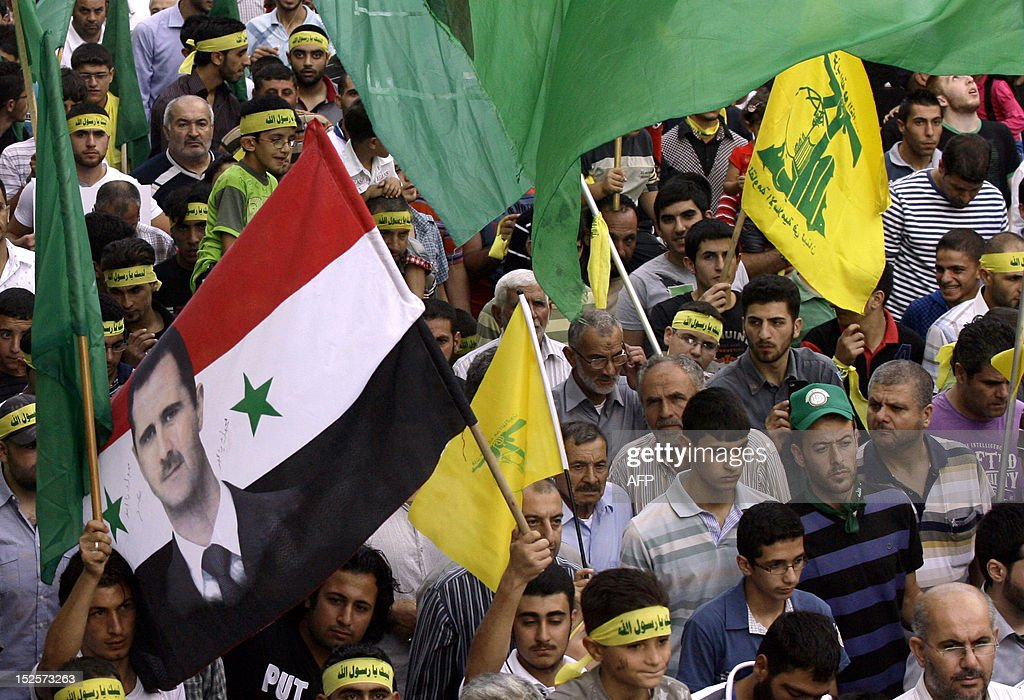 Lebanese Shiite Muslim movements Hezbollah and Amal supporters protest in the southern town of Bint Jbeil on September 22, 2012, against a US-made film mocking Islam and cartoons of the Prophet Moh...