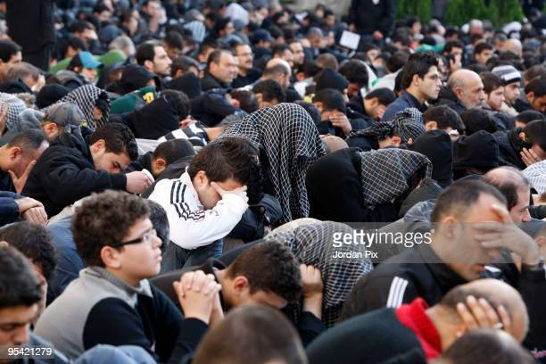 Lebanese Shiite Muslims march during a mourning ceremony organized by the Shiite Hezbollah movement to mark the final day of Ashura on December 27...