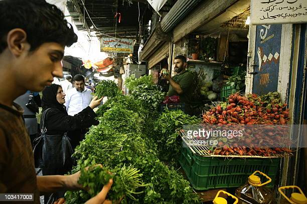 lebanese shop for vegetable ahead of the Iftar or breaking of the daylong fast in old market in the ancient coastal city of Tripoli north of Beirut...