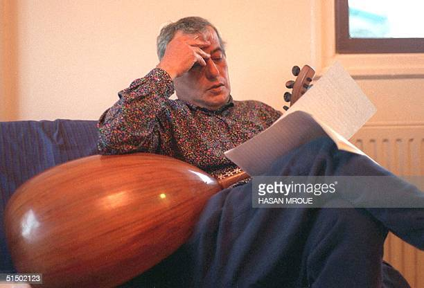 Lebanese singer and composer Elie Shweiry, his oud on his lap, works on a new song, in Nicosia, Cyprus in 1990. Shweiry began his career as a solo...
