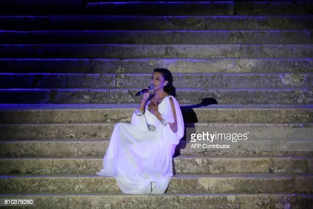 Lebanese singer Brigitte Yaghi performs during the opening of the Baalbek international festival in Lebanon's eastern Bekaa Valley on July 7 2017 /...
