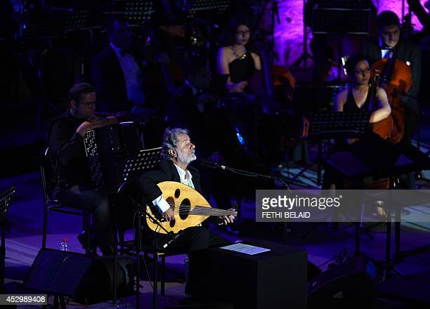 Lebanese singer composer and oud player Marcel Khalifeh performs during the 50th session of the International Carthage Festival on July 312014 at the...