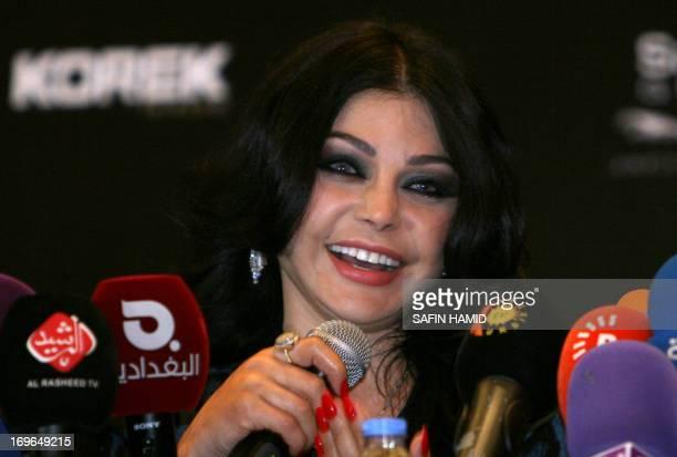 Lebanese singer Haifa Wehbe speaks during a press conference with Iraqi singer Hatim alIraqi before their performance in the northern Iraqi Kurdish...