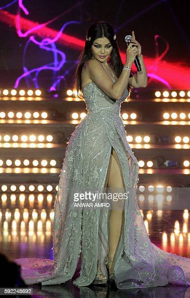 Lebanese singer Haifa Wehbi performs during the 'Mr Lebanon' title during the beauty contest in Jounieh north of the Lebanese capital Beirut on...