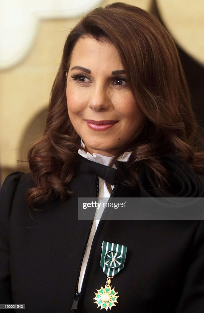 Lebanese singer, Magida al-Roumi poses after being awarded with the Officer of the Order of Arts and Letters medal by French ambassador to Lebanon on January 24, 2012 in Beyrouth. STR
