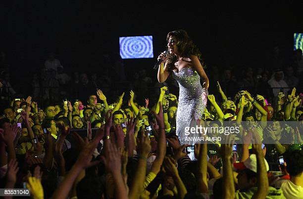 Lebanese singer Najwa Karam performs at a live concert with a laser light show in Beirut at a grand ceremony to launch the Emirati television music...