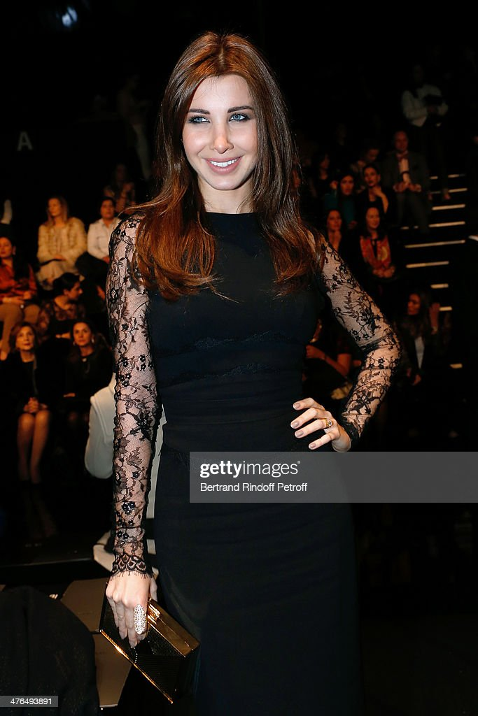 Lebanese singer Nancy Ajram attends the Elie Saab show as part of the Paris Fashion Week Womenswear Fall/Winter 2014-2015 on March 3, 2014 in Paris, France.