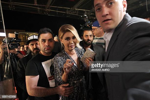 Lebanese singer Nawal Al Zoghbi arrives for the 16th annual Murex d'Or awards ceremony held in Jounieh north of Beirut on May 28 2016 / AFP / ANWAR...