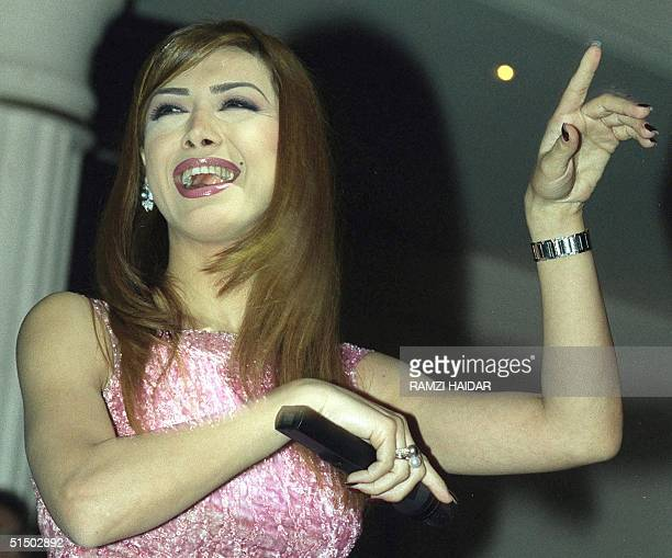 Lebanese singer Nawal alZoghbi performs during a concert at a night club in Tabarja 19 March 2000 marking the end of the Muslim Eid alAdha