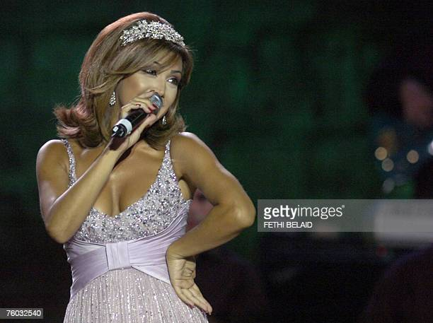Lebanese singer Nawal alZoghbi performs during the International Carthage festival late 08 August 2007 at the Roman amphitheatre in the ancient...