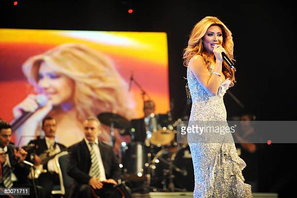 Lebanese singer Nawal alZoghbi performs in the Gulf emirate of Dubai late September 30 2008 as part of celebrations of the Eid AlFitr holiday The...