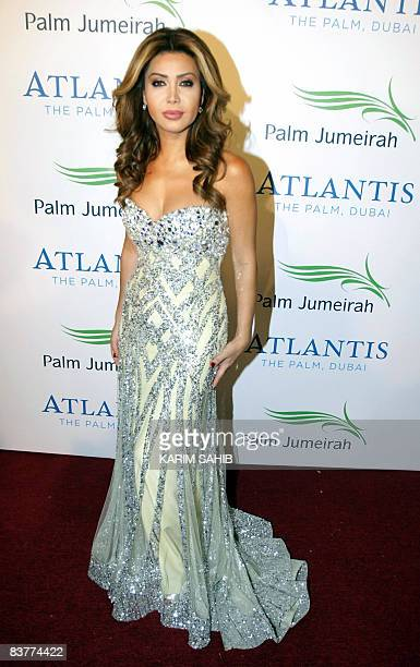 Lebanese singer Nawal alZoghbi poses for a picture at the official grand opening party for the Atlantis Hotel on the Palm Jumeirah in Dubai on...