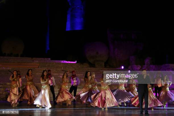 Lebanese singer Ramy Ayach performs during the opening of the Baalbek international festival in Lebanon's eastern Bekaa Valley on July 7 2017 / AFP...