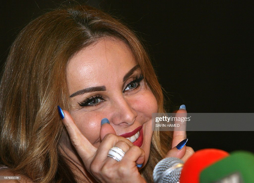 Lebanese singer Rola Saad speaks during a press conference prior to her performance in the northern Iraqi city of Arbil on May 2, 2013.