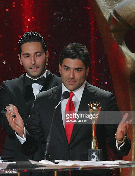 Lebanese singer Wael Kfoury gestures as he accepts his Murex d'Or award for best male Lebanese singer during a ceremony at the Casino du Liban in...