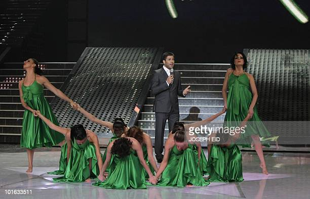 Lebanese singer Wael Kfoury performs during the final of Star Academy a highly successful panArab television show produced by Lebanese Broadcasting...