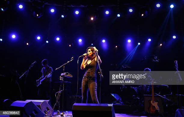 Lebanese singer Yasmine Hamdan performs on stage during a concert at the Music Hall in Beirut on June 8 2014 Hamdan was casted in Jim Jarmusch's new...