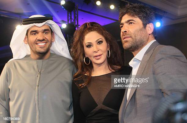 Lebanese singers Wael Kfoury and Elissa pose for a picture with Emirati singer Hussein alJasmi during a press conference to announce the launching of...