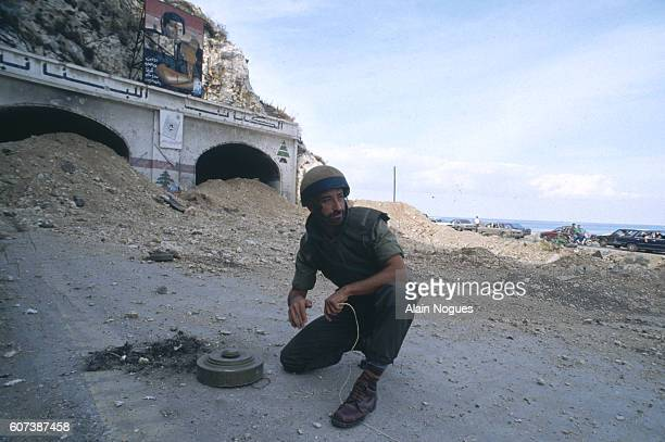 A Lebanese soldier carries out a mine clearance process in Beirut after the surrender of General Aoun former Prime Minister of Lebanon